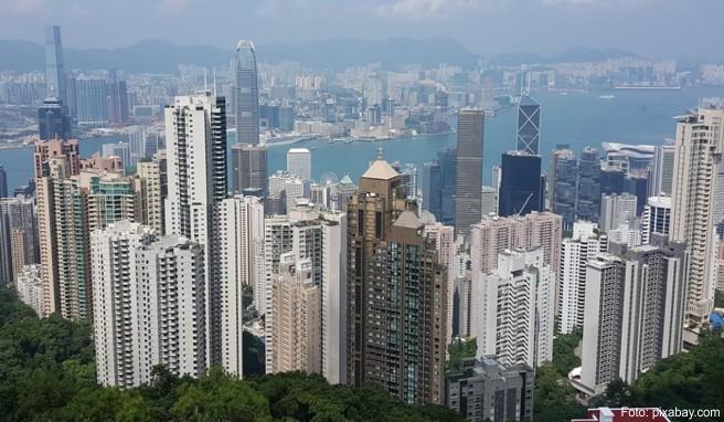Die kosmopolitische Metropole am Perlfluss überrascht mit einer Mixtur aus britischem Charme und chinesischen Traditionen