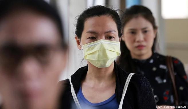 Wegen der schlechten Luft verhüllen die Bangkoker Mund und Nase wie noch nie